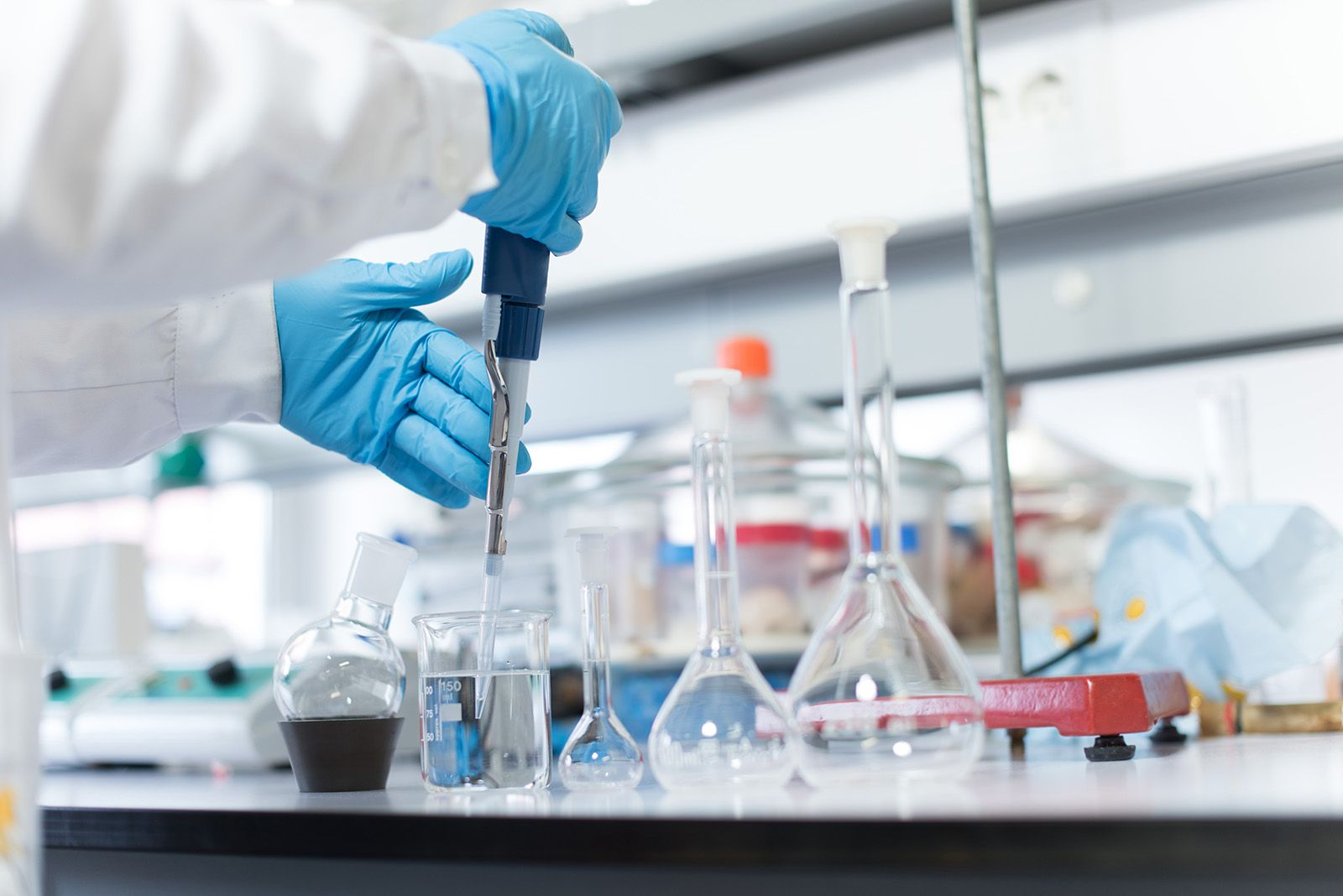 Chemical scientist working in modern biological laboratory